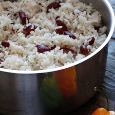 Jamaican Red Beans and Rice Recipe Main Dishes, Side Dishes with coconut oil, garlic cloves, onions, scallions, fresh thyme, red kidnei beans, rins and drain, long-grain rice, ground pepper, salt, water, light coconut milk, hot pepper