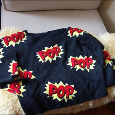 "Fun graphic sweater ""pop"" The top really does pops. This is a light knit with the words ""pop"". This top is a party all by it's self. Pair it with your favorite jeans or layer it over a basic top and your good to go. Size S/P Sweaters Crew & Scoop Necks"