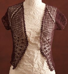 Show off your crochet skills with this delicate and intricate raglan cardi made with our LB Collection® Wool Stainless Steel.