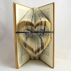 Folded Book Art Heart -- close-up of book with indented pages