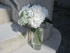 Décoration florale, mariage chic, hortensias blanc, gypsophile, palace de Menthon