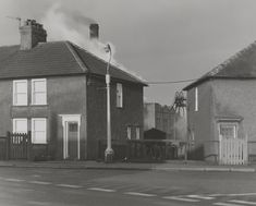 """Chris Killip  'Houses with Pit Wheel in Background. Workington', 1976, printed 2012–13"""