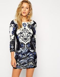 Beautiful rich hues of dark blue to sparkling white in this Needle & Thread Midnight Floral Mini Dress from ASOS. This would be for my teen girls Homecoming.
