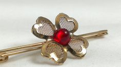 Dainy gold tone mesh and ruby red flower or four leaf clover lingerie pin or brooch. The perfect accessory for your wedding night or honeymoon.