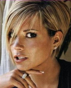 Short and sassy haircut....but shewould be beautiful with no hair!