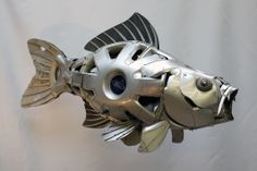 Just finished a Carp commission. Here it is.... Hubcap Creatures