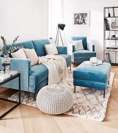 Contemporary eclectic design, modern furnishings, patterned rug, upholstered seating, teal accents, pouf seating