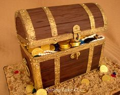 treasure+chest+cake+-+Inspired+by+another+cake+created+by+rouvelee+found+on+flickr+site.++The+bottom+part+is+cake+and+the+lid+is+styrofoam.++I+used+purchased+chocolate+coins,+but+handmade+the+jewels+and+pearls.++So+much+fun!