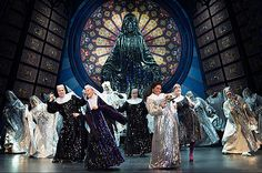 This is a photo from the Broadway performance of Sister Act. In this set  design the long angled lines, and the large round shape of the stain glass windows give off a feeling of reverence, and can be considered intimidating. This is in stark contrast to the performance that is happening on the stage. This was more than likely done to accentuate the ironic humor throughout the show…