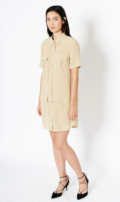 A utility inspired dress in heavier, heritage fuju silk, the Remy Dress features front military style pockets, short sleeves, shirt collar and rounded hem.