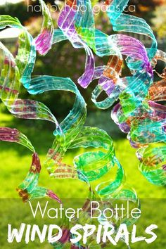 Summer craft idea: Turn empty water bottle into these cool garden art spirals.  Learn how you can turn empty plastic bottles into pretty yard art with a few simple supplies  ( great project for the kids :)