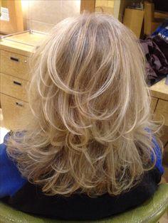Beautiful medium length layered hair cut.