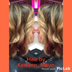 Red peekaboo with blonde balayage ombré on a short haircut bob
