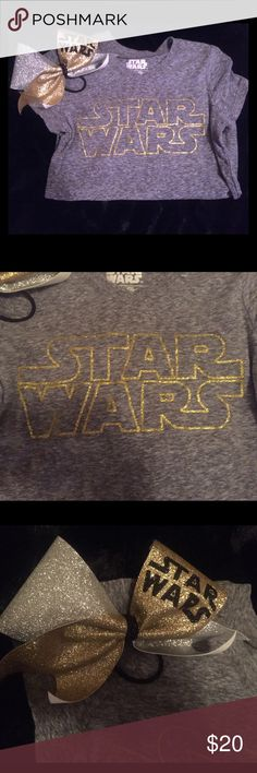 Girls Star Wars shirt and matching bow. Grey V neck shirt with Star Wars written in glittery gold. The shirt is a large for a girl size10-12. The bow is a cheer bow in perfect condition. Shirts & Tops Blouses