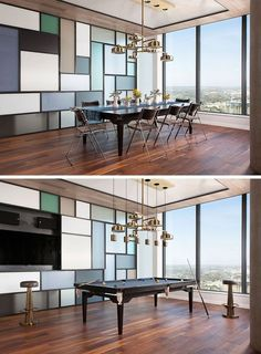 This modern apartment has a steel and glass wall that's reminiscent of a Piet Mondrian art piece. A section of the wall opens to reveal a television, while the custom-designed dining table can easily transform into a pool table. Glass Wall Design, Tv Wall Design, Wall Shelves Design, Office Wall Design, Office Walls, Office Decor, Apartment Interior, Apartment Design, Inspiration Wand