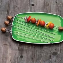 This set of 4 skewers features rosewood handles which provide a firm grip, and double prongs that secure food on the skewer. - Rosewood Handle Double Prong Skewers