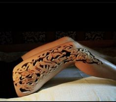 The talent and imagination to produce this tattoo is simply awesome.  The image of a finely carved wooden limb is so realistic that I would worry about carpenter ants trying to nest in it.  Truly, this is art, whether concept or reality.