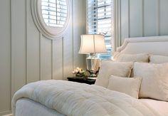 all white, board and batten, oval window