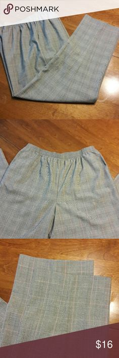 """Alfred Dunner Pants Size 16 short NWT Alfred Dunner pants with elastic waist and front pockets. Size is 16 short. Measurements are approximate taken with garment laying flat. Waist: 16"""" Frost rise: 12.5"""" Total length: 38.5"""" Alfred Dunner Pants"""