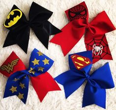 4 piece Super Hero Cheer Bow Set! SUPERMAN BATMAN WONDER WOMAN AND SPIDER-MAN! all 4 are spandex with glitter accents! Free Shipping! Ponytail holder attached!
