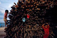 Alex Webb - KENYA. Lamu. 1984. Lamu town child with mangrove poles