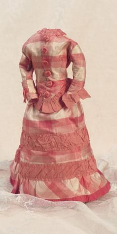 """Fa'vours in Candlebeam Rooms: 287 French Silk Gown for Poupee uitable for 15"""" (38 cm) poupee of 1870 era. Of rose and cream silk plaid the two piece ensemble features fitted jacket with button front,flat front skirt with demi-train and ribbon tie-backs that gather the full gathers at the back. Excellent condition. Circa 1870."""