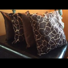 17x17 giraffe/brown throw pillow covers Awesome set of four giraffe Faux fur and brown solid suede throw pillow covers. Great for any room of the house brand-new still in factory packaging. Posh Spaces Other