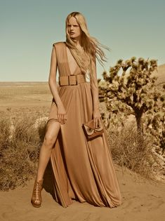 Hanne Gaby Odiele poses in a maxi dress pose for Elisabetta Franchi spring summer 2016 campaign