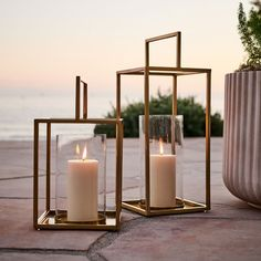 These Framed Lanterns have a minimalist design, yet elegantly draw attention towards the candle nestled within its metal frame. Outdoor Candle Lanterns, Floor Lanterns, Modern Lanterns, Lantern Candle Holders, Metal Lanterns, Lanterns Decor, Outdoor Flooring, Candle Sconces, West Elm