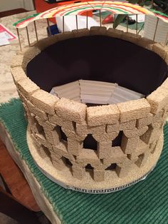 Roman Colosseum (6th Grade)- Foam base, Styrofoam Project Bricks, contraction paper.