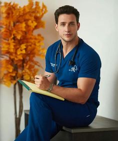 It hurts right 'here'.please touch me and make it better! Doctor Mike, Dr Mike Varshavski, Hot Doctor, Male Doctor, Medical Photography, Lgbt, Men In Uniform, People Magazine, Men Style Tips