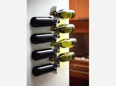 Stainless steel wine rack, holds up to eight bottles using a minimum of space.
