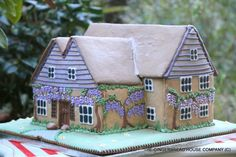 A wisteria covered gingerbread house - how freakin brilliant!! - Cake by Sayitwithginger