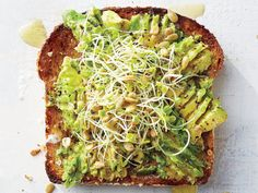 169 cal Avocado-Sprout Toast ripe avocado, sliced Dash of kosher salt Dash of black pepper cup alfalfa sprouts 2 teaspoons sunflower seeds teaspoon fresh lemon juice Sprout Recipes, Veggie Recipes, Vegetarian Recipes, Healthy Recipes, Veggie Food, Protein Recipes, Healthy Meals, Healthy Food, Smashed Avocado On Toast
