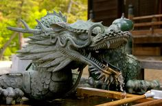 The temple of Kiyomizu-dera is perhaps the most important in Kyoto, placed on a dominant position above the city. Is part of UNESCO World Heritage. This dragon it's placed on the ablution fountain.