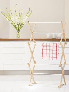 If space permits, add a retractable clothesline or folding drying rack to the laundry center. Even if the house has an automatic dryer, a clothesline or rack makes it a quick matter to dry sweaters and underthings that should not be placed in the dryer.