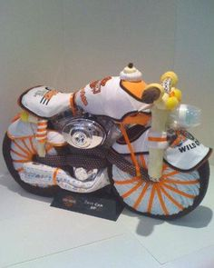 Art Picture: Harley Davidson motorcycle Diaper Cake, nappy cakes, baby shower gift ideas provided by Baby Favors And Gifts Brooklyn, NY 11234 other-nerdy-stuff-i-love Bebe Shower, Baby Shower Fun, Baby Shower Parties, Shower Party, Trendy Baby, Diaper Motorcycle Cake, Baby Favors, Unique Baby Shower Gifts, Baby Party