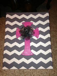 DIY canvas. Just get a blank canvas and cover with fabric by stapling into the back of the canvas. You can find any shape at Hobby Lobby for around 3.00. I painted it and glued a flower to the center. It's so cute and easy!!!