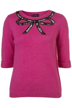 Topshop bow sweater (or jumper as they like to say), $76.  Very Emma Pillsbury.
