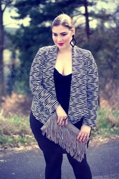 the clutch is superb with this jacket.Femme fatale make up : )