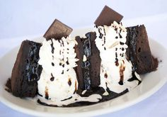Here's today's clue on our new cake: What's on our plate? CHOCOLATE + ice cream + whipped cream bliss! [Godiva Chocolate Brownie Sundae]  from The Cheesecake Factory
