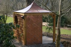 Copper roofed garden room, created for RHS Rosemoor in Devon.  This photograph effectively illustrates the concave curve of the roof design; complexities which are possible due to the malleability of the material.
