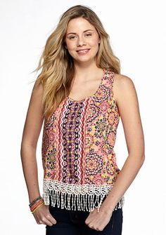 Elevate your warm weather wardrobe with this must-have Red Camel® tank! Featuring on-trend fringe details and an India-inspired pink and yellow print, this piece is ideal for creating a fashionable look this season.