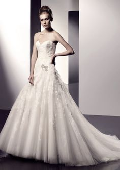 Erin from the 2010 #Enzoani collection....this was my wedding dress! Minus the bow applique ;)