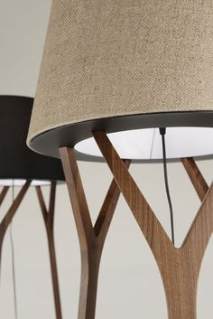 Wood and fabric in a sleek design conceptualizing the shapes of nature. TRE' proposes linen diffusers on a triple handcrafted canaletto walnut wood stem. Available in two versions: table and free-standing with energy-savers sources. #tretablelamp #treandcostalamps #andcostalamps #andcostalights #andcostalighting #lights #lamps #lighting #design #architecture #interiordesign #woodtablelamps