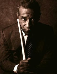 Max Roach (born Maxwell Lemuel Roach), jazz percussionist, drummer, & composer. A pioneer of bebop, he went on to work in many other styles of music, and is considered among the most important drummers in history. He worked with many famous jazz musicians, including Dizzy Gillespie, Charlie Parker, Miles Davis, Duke Ellington, & Thelonious Monk. His most significant innovations include devising a new concept of musical time - a flexible rhythmic pattern that allows soloists to play freely.