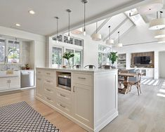 Modern farmhouse. Epic kitchen layout, vaulted ceilings and skylights. White pine floors.