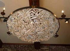 Oyster shell sconces category archives let there be light loving amen street restaurant in charleston oyster shell chandelier obsessed aloadofball Image collections