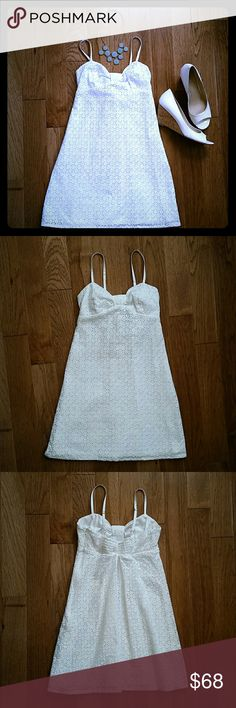 """Lilly Pulitzer White Eyelet Dress Pristine condition dress, perfect for spring and summer parties!  Back has ruching, so there's some flex in the fit.  Fully lined.  100% cotton, hand wash.  Truly more beautiful in person than a camera can capture!    25"""" long from top of bust (minus straps) to hem, 13.5"""" at widest part of bust (not including extra stretch from ruching), 12"""" across at smallest part of waist.   (Accessories pictured not included) Lilly Pulitzer Dresses"""