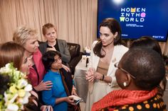Garrett Popcorn makes a cameo behind the scenes with Angelina Jolie at Women in The World [Photo Credit: Samantha Appleton] #WITW